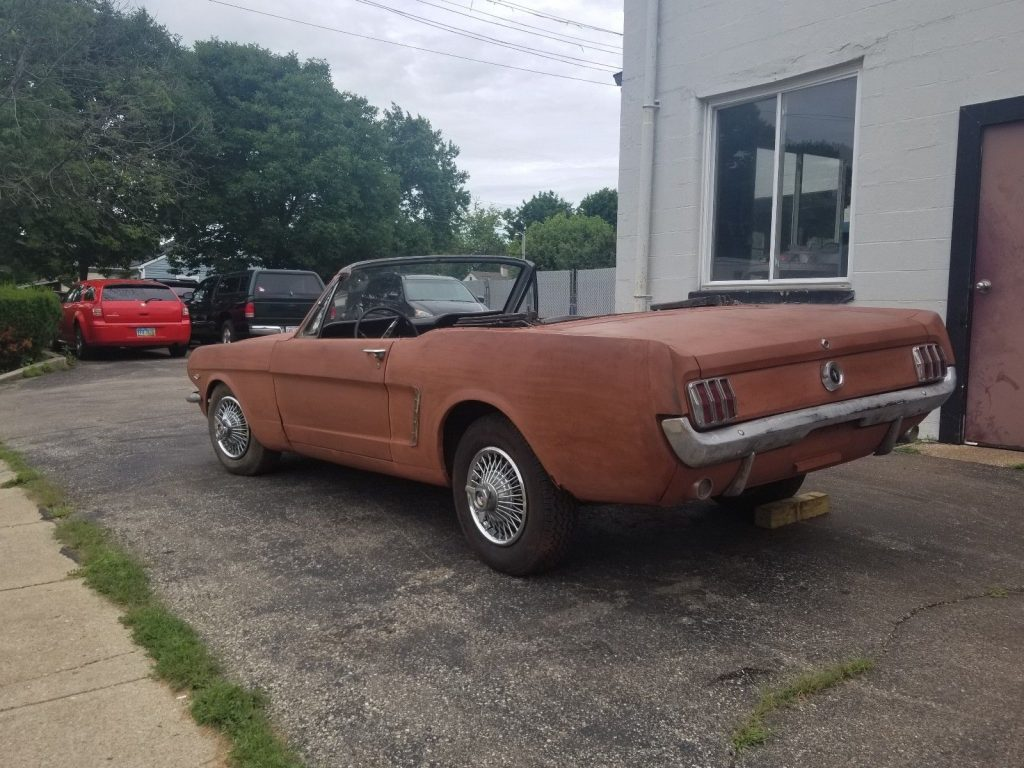 solid 1965 Ford Mustang Convertible